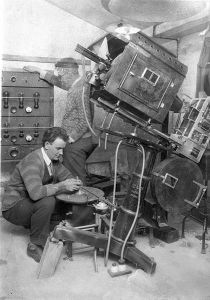 sound_technicians_setting_up_the_turn-table_and_amplifiers_for_the_first_-talkies-_in_australia_1927-1928_2877787608